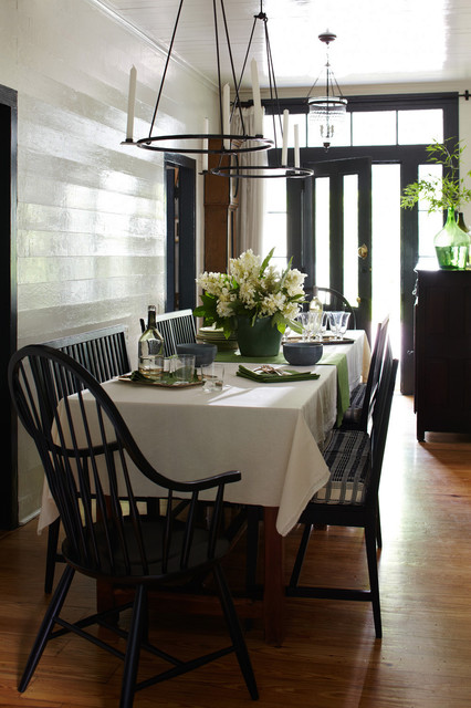 Small cottage light wood floor dining room photo in Austin with white walls