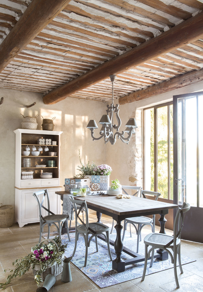 Enclosed dining room - mid-sized french country travertine floor and brown floor enclosed dining room idea in London with white walls and no fireplace