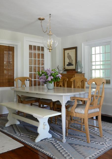 Coastal medium tone wood floor dining room photo in Boston with white walls