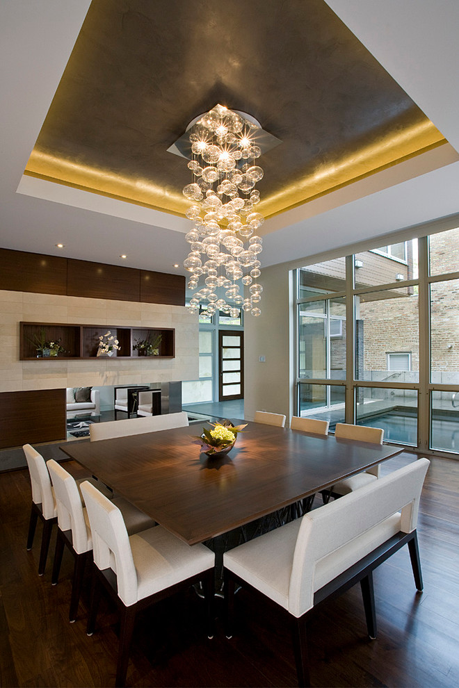 Inspiration for a contemporary dining room remodel in Chicago with a corner fireplace