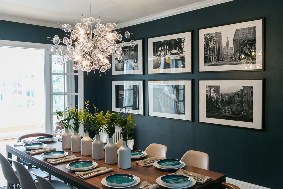 Example of a mid-sized eclectic medium tone wood floor enclosed dining room design in DC Metro with blue walls