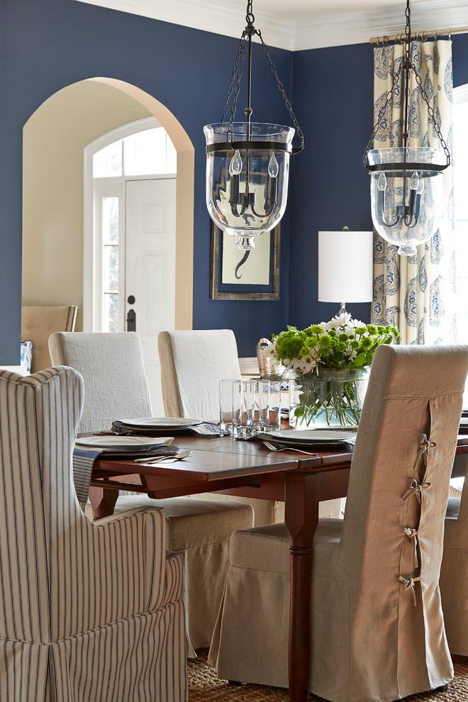 Elegant great room photo in Atlanta with blue walls