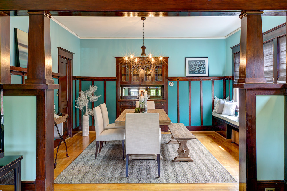 Arts and crafts medium tone wood floor enclosed dining room photo in Seattle with blue walls