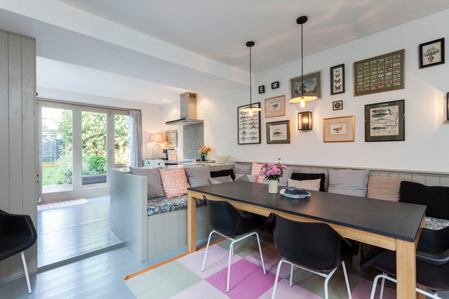 Design ideas for a scandi kitchen/dining room in London with white walls and painted wood flooring.