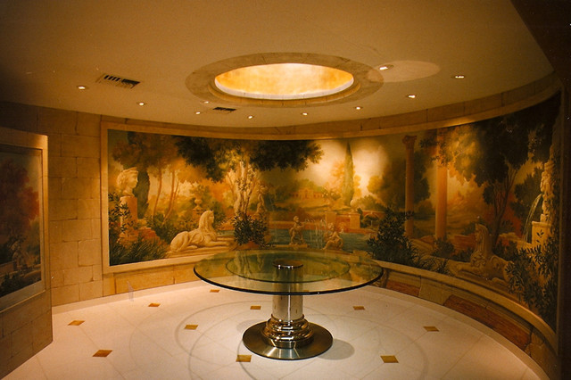Curved dining room with Italian jungle ruins on Mural. eclectic-dining-room
