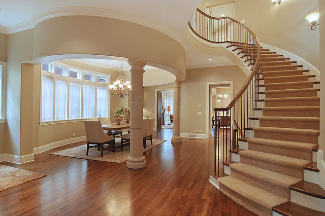 Curved Stair & Oval Formal Dining Room contemporary dining room