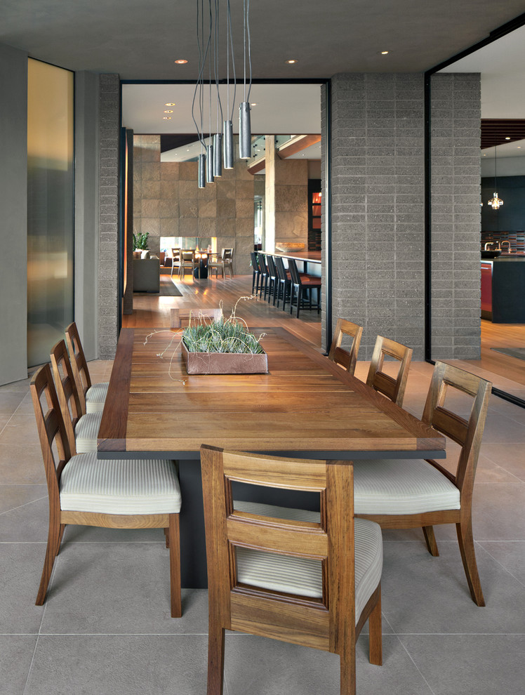 Southwest dining room photo in Phoenix with gray walls