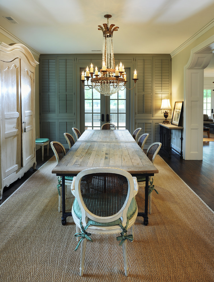 Example of a classic dark wood floor enclosed dining room design in Nashville with beige walls