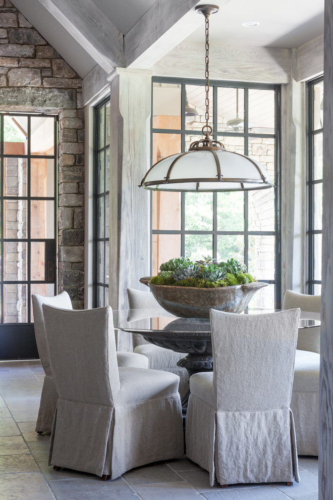 Example of a small transitional gray floor and limestone floor great room design in Nashville with beige walls