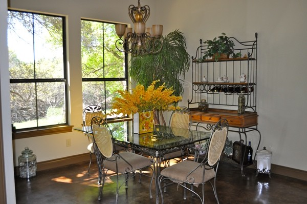 Tuscan dining room photo in Austin