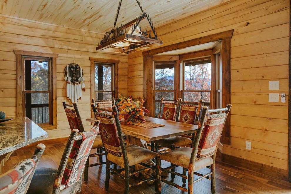 Dining room - southwestern medium tone wood floor dining room idea in Atlanta