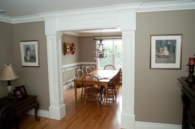 Customized moulding in new home traditional dining room for Dining room molding ideas