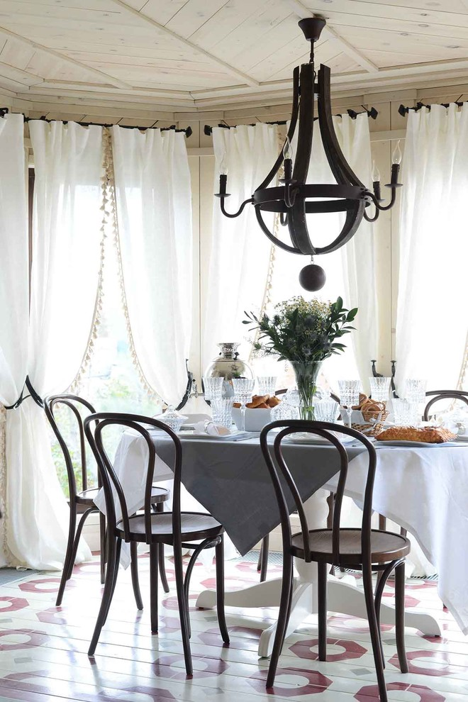 Inspiration for a country painted wood floor dining room remodel in Moscow with beige walls and no fireplace