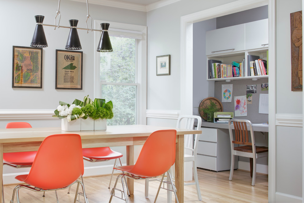 Enclosed dining room - transitional light wood floor enclosed dining room idea in Raleigh with gray walls