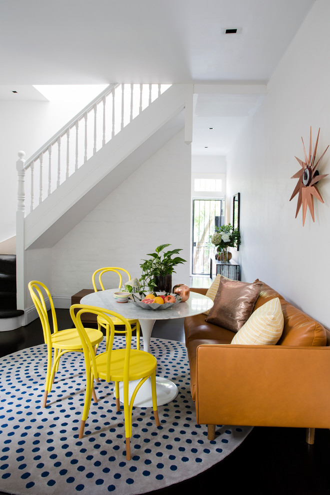 Example of an eclectic dining room design in Sydney with white walls