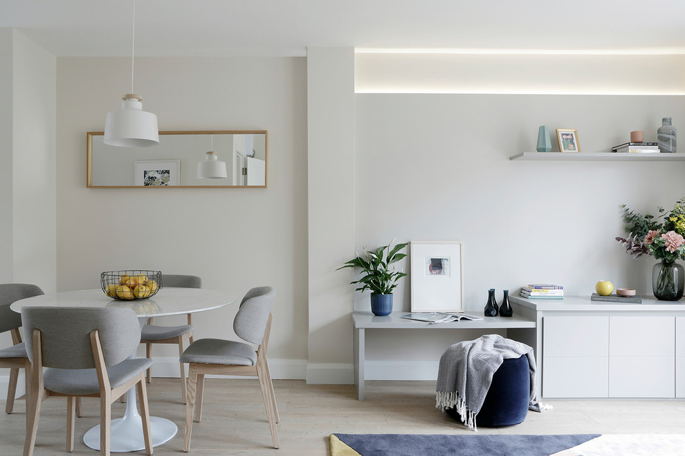 Dining room - mid-sized scandinavian light wood floor and beige floor dining room idea in Other