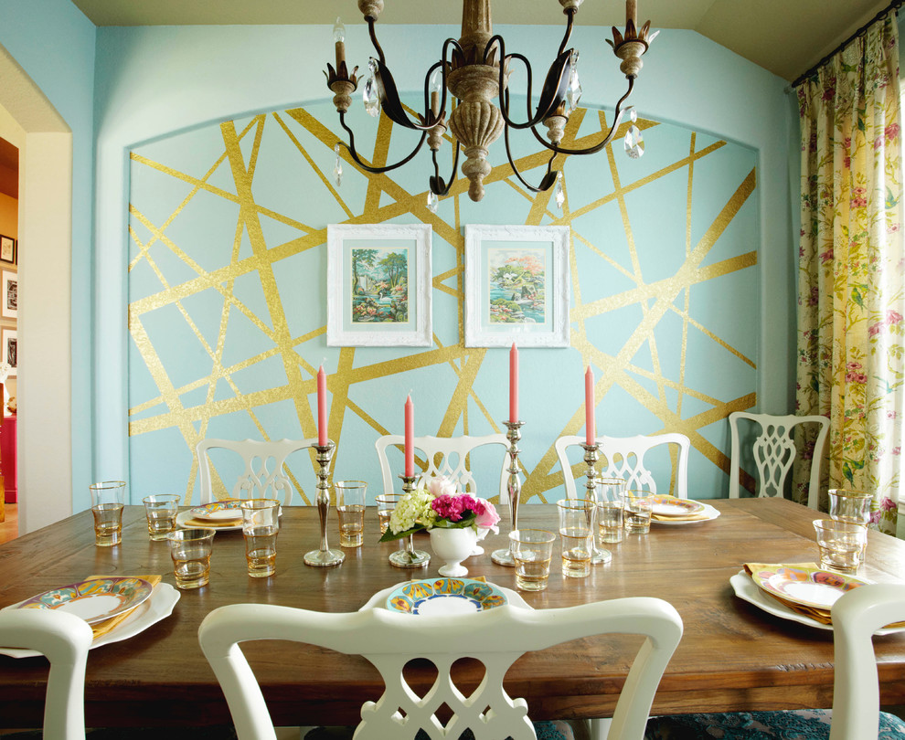 Inspiration for a mid-sized eclectic dark wood floor and brown floor enclosed dining room remodel in Houston with blue walls and no fireplace