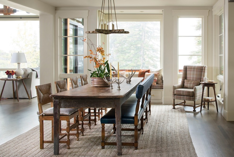 Example of a mountain style medium tone wood floor great room design in Seattle with gray walls