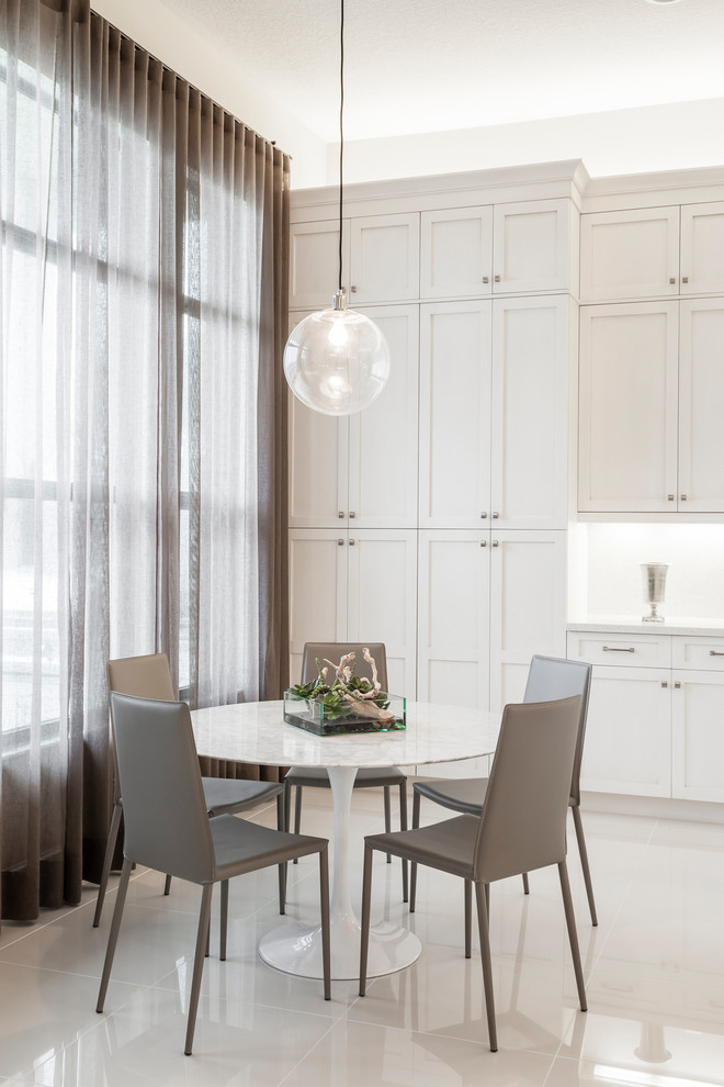 Transitional kitchen/dining room combo photo in Miami with white walls