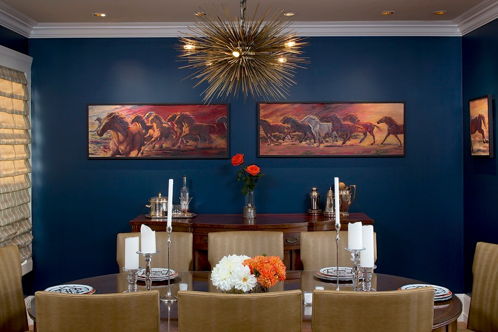 Example of an eclectic dining room design in San Francisco with blue walls