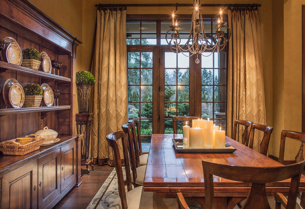 Example of a classic dark wood floor dining room design in Seattle