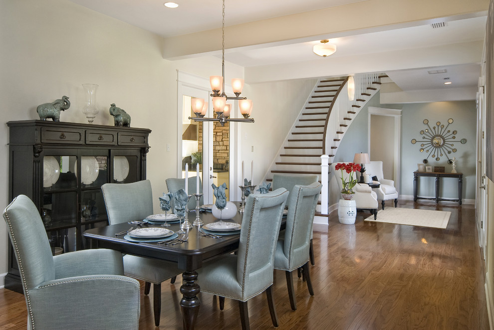 Dining room - contemporary medium tone wood floor dining room idea in Other with beige walls