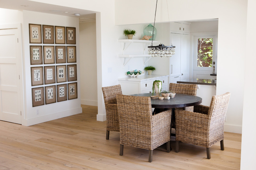 Inspiration for a contemporary light wood floor and beige floor kitchen/dining room combo remodel in Los Angeles with white walls