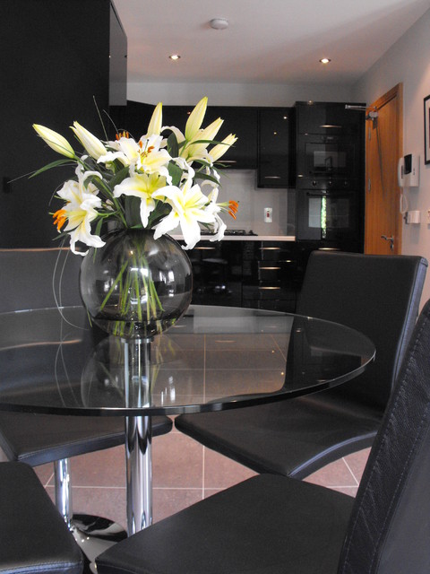 Dining Area With Glass Table Black Swivel Chairs