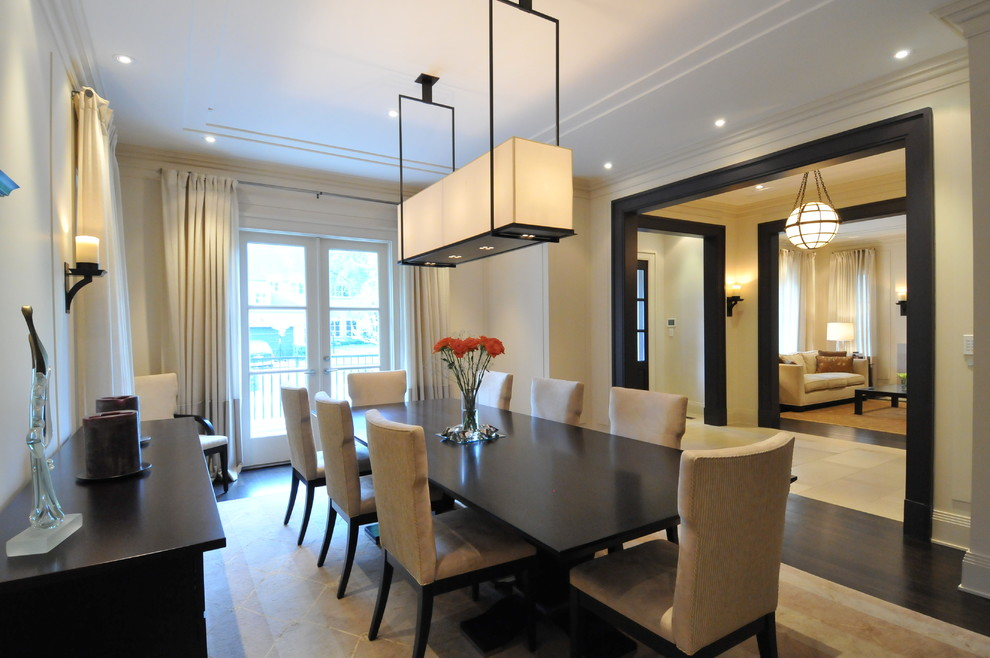 Transitional dining room photo in Toronto with beige walls