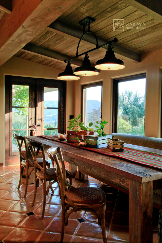 Mid-sized farmhouse terra-cotta tile dining room photo in Santa Barbara with white walls and no fireplace