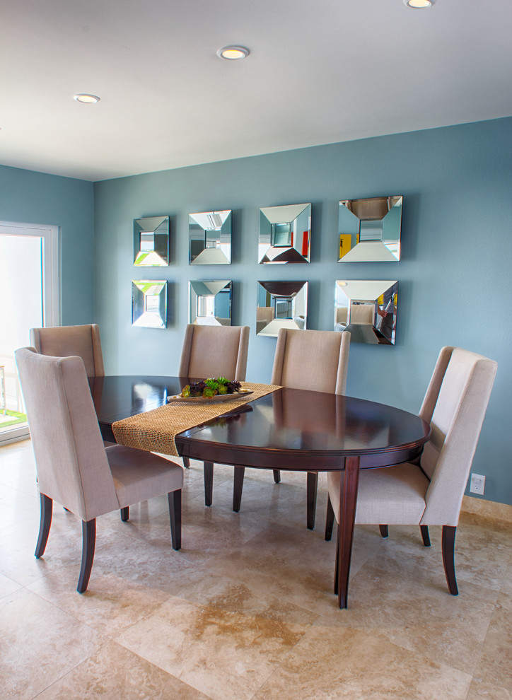 Dining room - transitional dining room idea in Orange County with blue walls