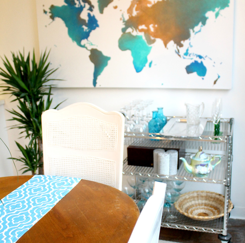 Example of a small minimalist enclosed dining room design in Detroit with white walls