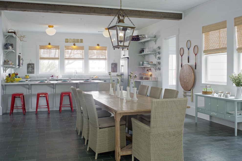Example of a large beach style slate floor and gray floor great room design in Atlanta with white walls and no fireplace