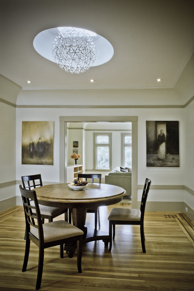 Inspiration for a timeless medium tone wood floor dining room remodel in San Francisco with white walls