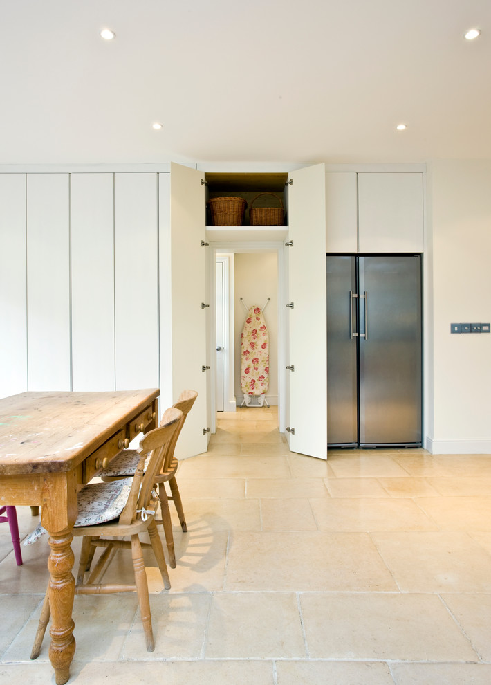Dining room - contemporary dining room idea in Surrey with white walls