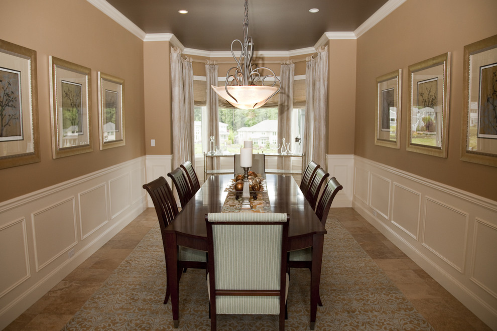 Enclosed dining room - large traditional porcelain tile and beige floor enclosed dining room idea in Phoenix with brown walls and no fireplace