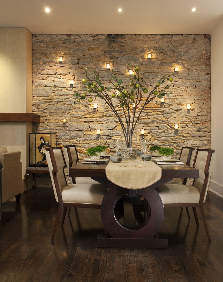 Inspiration for a contemporary dark wood floor and brown floor dining room remodel in Minneapolis with beige walls