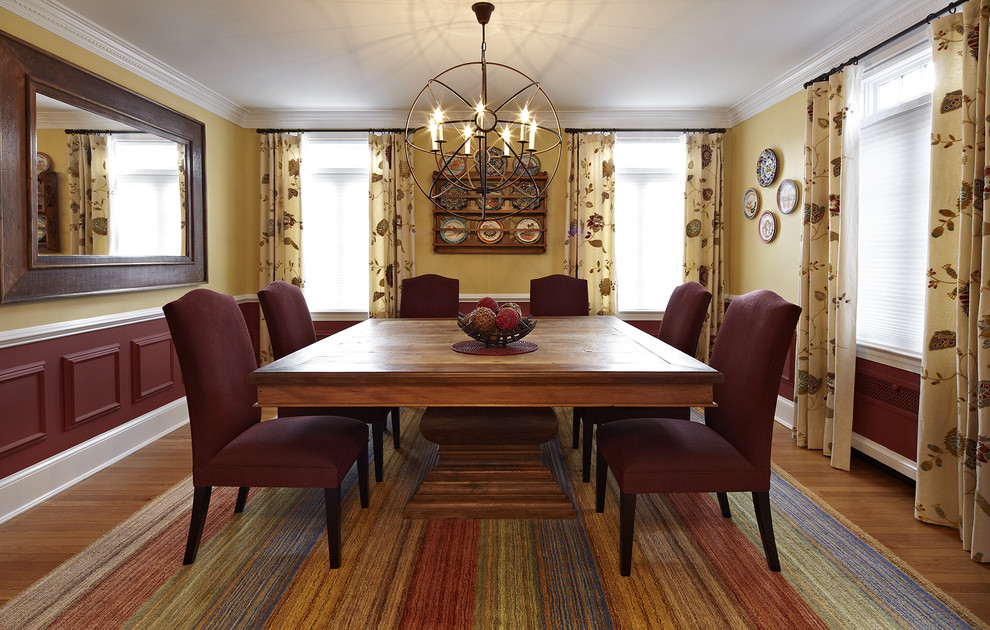 Example of an eclectic dining room design in DC Metro with multicolored walls
