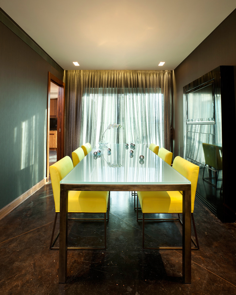 Dining room - contemporary concrete floor dining room idea in Other