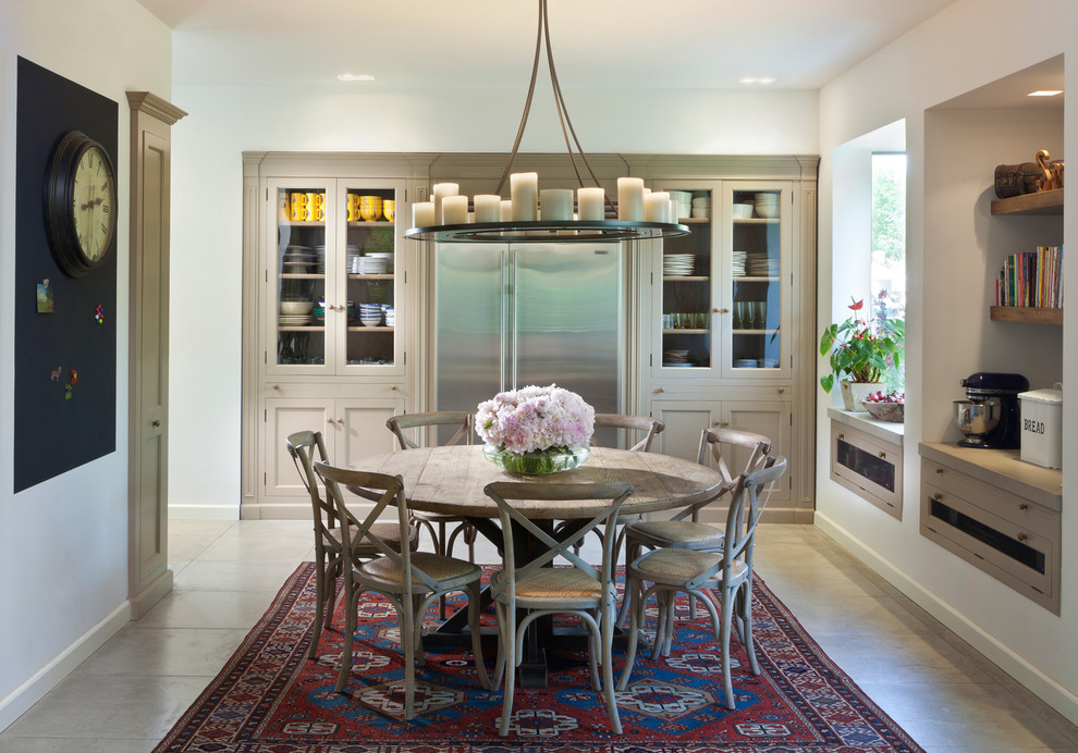 Elegant dining room photo in Other with white walls