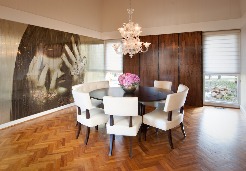 Dining room - modern medium tone wood floor dining room idea in Baltimore with no fireplace and metallic walls