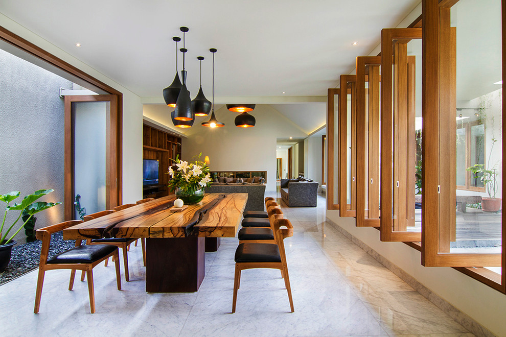 Inspiration for a large contemporary great room remodel in Other with white walls