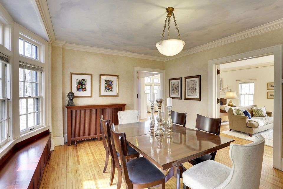Dining Room full of charm with the bowed window seat.
