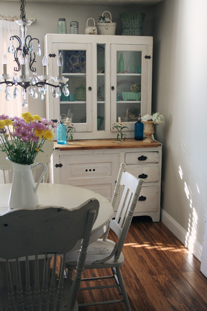 Dining room - shabby-chic style dark wood floor dining room idea in Other with gray walls