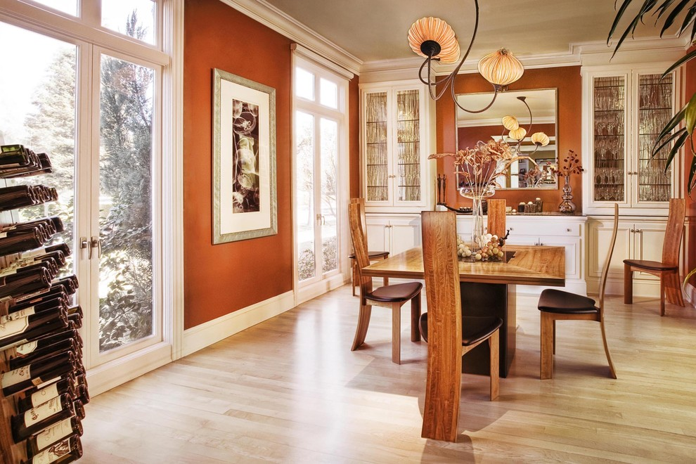 Dining room - contemporary light wood floor and beige floor dining room idea in San Francisco with brown walls