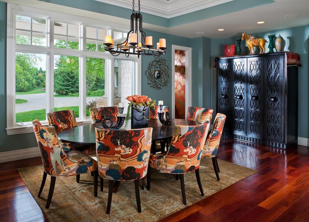 Trendy dark wood floor dining room photo in Minneapolis with blue walls