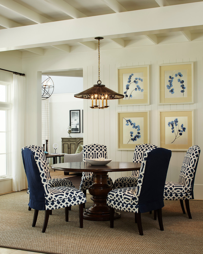 Enclosed dining room - mid-sized traditional enclosed dining room idea in Miami with white walls and no fireplace