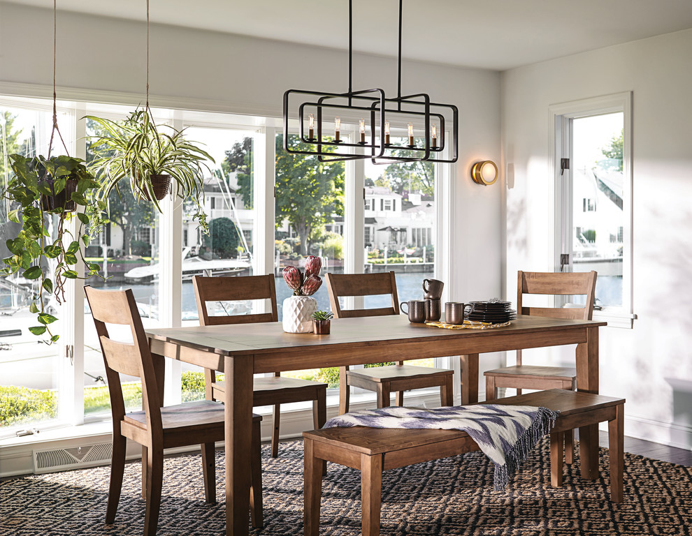 Inspiration for a mid-sized cottage medium tone wood floor and brown floor dining room remodel in Philadelphia with white walls and no fireplace