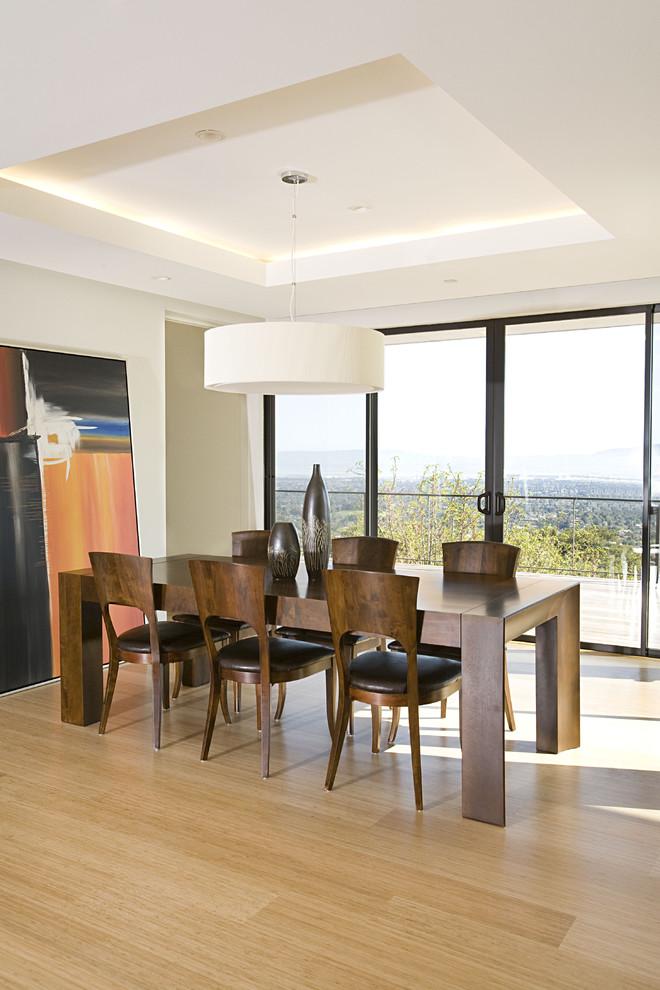 Example of a trendy bamboo floor and beige floor dining room design in San Francisco