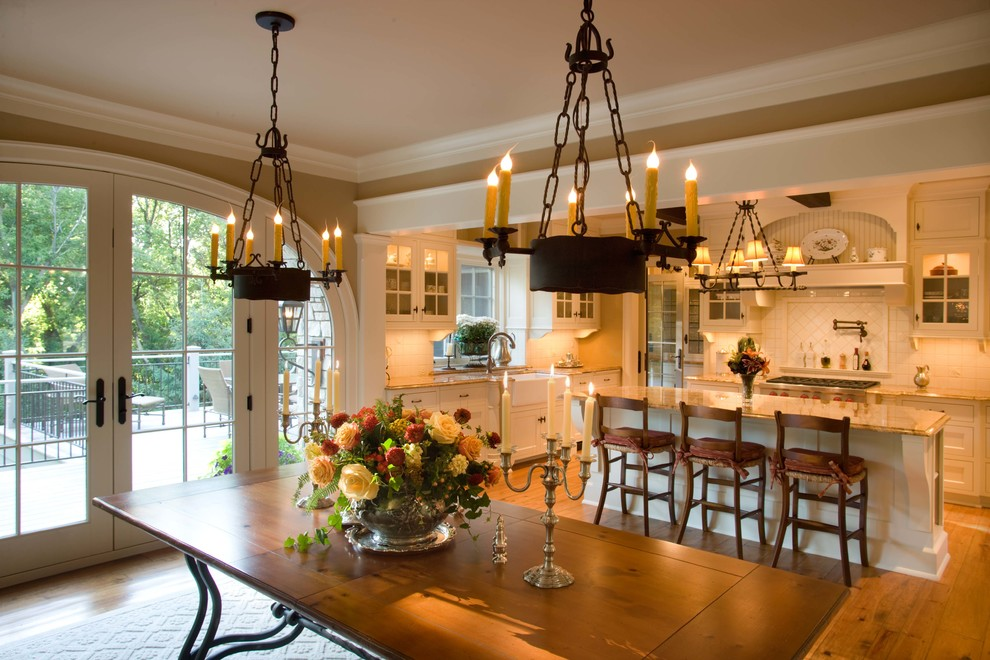 Example of a classic medium tone wood floor and brown floor kitchen/dining room combo design in Minneapolis